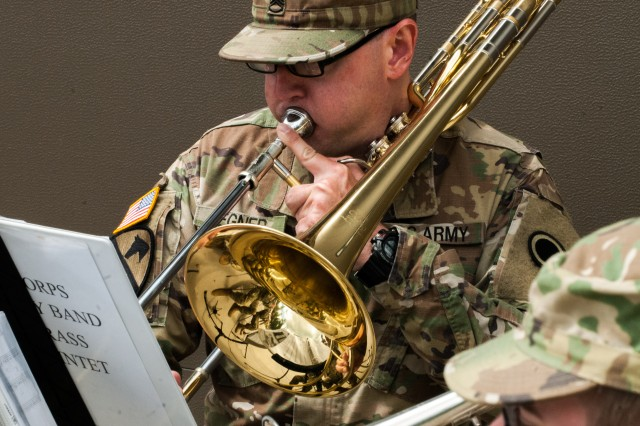 "A Soldier with the 56th Army Band, ""America's Corps Band,"" plays through a rendition of The Army Song at the 301st MEB change of command ceremony held at Joint Base Lewis-McChord, Washington June 4, 2017. Founded in 2008, the 301st Maneuver Enhancement Brigade is one of three MEB's in the�Army Reserve. The MEB is a unique multifunctional mission command headquarters designed to perform maneuver support operations for the echelon it supports (U.S. Army Reserve photo by Spc. Sean Harding, 301st Maneuver Enhancement Brigade)."