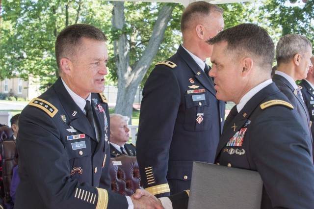 Gen. Dan Allyn, Vice Chief of Staff of the Army, congratulates Army Col. Collin Hunton as he accepts his diploma during the Army War College Graduation, June 9.