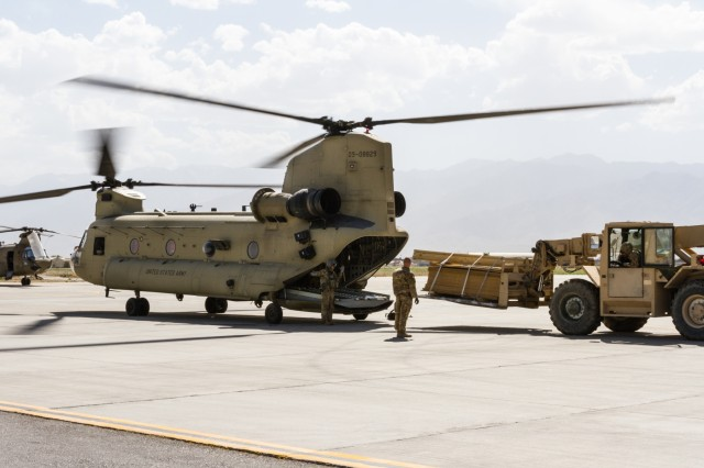 U.S. Army soldiers assigned to Task Force Flying Dragons, 16th Combat Aviation Brigade, 7th Infantry Division load cargo on a CH-47 Chinook helicopter at Bagram Airfield, Afghanistan, June 9, 2017. The Flying Dragons provide aviation support to U.S. Forces Afghanistan as part of Operation Freedom's Sentinel.