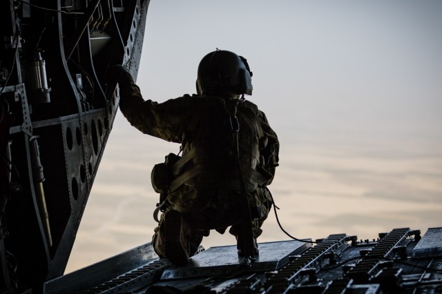 A U.S. Army CH-47 Chinook helicopter crew chief assigned to Task Force Flying Dragons, 16th Combat Aviation Brigade, 7th Infantry Division scans below near Mazar-e-Sharif, Afghanistan, June 9, 2017. The Flying Dragons provide aviation support to U.S. Forces Afghanistan as part of Operation Freedom's Sentinel.