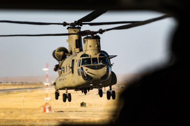 U.S. Army CH-47 Chinook helicopter pilots assigned to Task Force Flying Dragons, 16th Combat Aviation Brigade, 7th Infantry Division land at Mazar-e-Sharif Airfield, Afghanistan, June 9, 2017. The Flying Dragons provide aviation support to U.S. Forces Afghanistan as part of Operation Freedom's Sentinel.