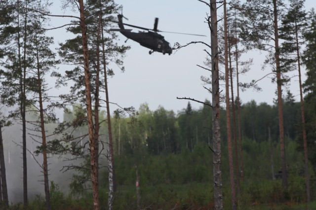 TAPA, Estonia - U.S. Army Apache helicopters provide air transportation for the causalities being treated and medically evacuated by the 10th Combat Aviation Brigade during Saber Strike 17 on Jun 10. Saber Strike is a U.S. Army Europe-led multinational combined forces training exercise in the Baltic region.� The exercise tests the capability of multiple nations to respond collectively against any threat. (U.S. Army photo by Staff Sgt. Jill People)� � �