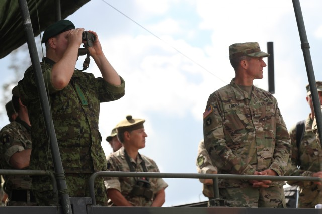 TAPA, Estonia - U.S. Army Maj. Gen. Neal Loidolt, on the right, assistant adjutant general for the Minnesota National Guard, St. Paul, Minn. and exercise director of the Saber Strike 17, and Estonian Gen. Riho Terras, on the left, commander of Estonian Defence Forces watch the Saber Strike 17 demonstration, as well as military leaders and media on Jun 10. Saber Strike is a U.S. Army Europe-led multinational combined forces training exercise in the Baltic region.� The exercise tests the capability of multiple nations to respond collectively against any threat.�(U.S. Army photo by Staff Sgt. Jill People)� �� � �  � �