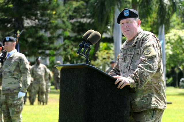 "Maj. Gen. Mark J. O'Neil, Chief of Staff, U. S. Army Pacific, speaks to attendees at a Flying ""V"" ceremony held at historic Palm Circle, Fort Shafter, Hawaii, June 9. The Flying ""V"" ceremony was held to honor O'Neil for his distinguished service as he prepares to depart USARPAC. The ""V"" refers to the way the colors are posted during the ceremony, which is V-shaped. (U.S. Army photo by Staff Sgt. Chris McCullough)"