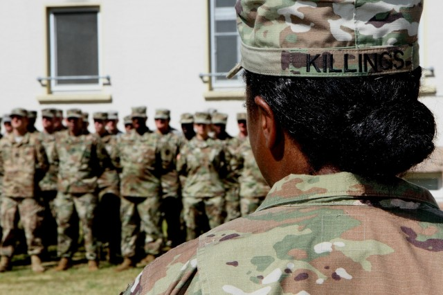 Capt. Ayahna N. Killings, new commander of Headquarters and Headquarters Company, 7th Mission Support Command, addresses her Soldiers in a speech during a combined change of command and change of responsibility ceremony Saturday June 10, 2017 at Daenner Kaserne in Kaiserslautern, Germany.