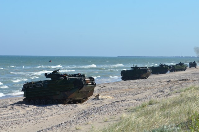 VENTSPILS, Latvia - U.S. Marine Amphibious Assault Vehicles from 2nd Assault Amphibian Battalion, 2nd Marine Division, II Marine Expeditionary Force, roll onto the beach at Ventspils, breaching the security of Latvian forces in an amphibious assault exercise for Baltic Operations, June 6.  The amphibious assault is a part of the 45th rendition of exercise Baltic Operations. Baltic Operations is an annual multinational, maritime-focused exercise designed to provide high quality training for its participants.  This year, 14 countries are participating in the exercise.  (U.S. Army photo by Sgt. Shiloh Capers)