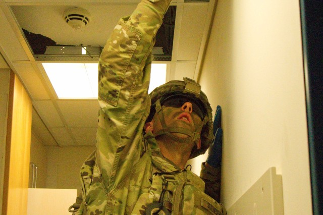 Pfc. Robert Stalnecker, a combat engineer assigned to Bravo Troop, Regimental Engineer Squadron, 2d Cavalry Regiment, U.S. Army, uses a mirror to search for hazards and evidence in the ceiling during training on Camp Aachen, Grafenwoehr Training Area, Germany June 7, 2017. Bravo Troop Soldiers participated in an explosive hazards search, detection, identification, and defeat training in order to gain proficiency on explosive hazard clearing operations with 3rd Company, 4th Panzer Pioneer Battalion, 15th Panzer Brigade, German Army.