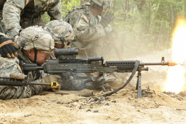 Infantrymen from Company B, 2nd Battalion, 121st Infantry Regiment, 48th Infantry Brigade Combat Team, fire an M240B during eXportable Combat Training Capability exercise June 11, 2017 at Fort Stewart. The exercise as part of the Associated Units Pilot Program to allow National Guard, Reserve and active units to train and deploy together.