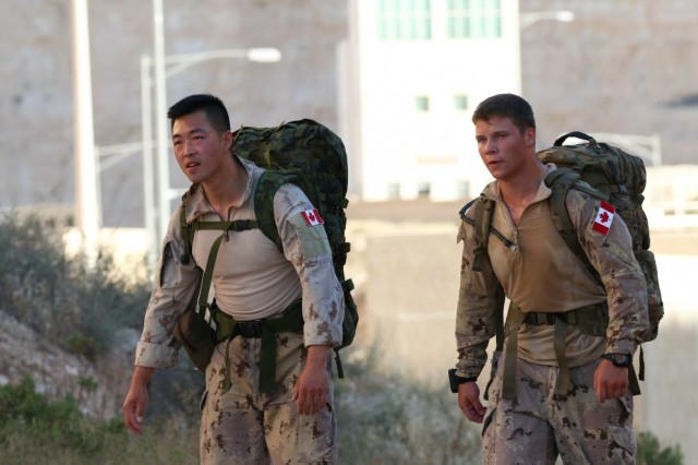 Capt. Han Choi (left) and Cpl. Jared Ewald of the Canadian Armed Forces complete a 12 km ruck march during the final day of qualification for the German Armed Forces Proficiency Badge May 29, 2017, near Amman, Jordan. Choi and Ewald joined a U.S. Air Force Airman and more than 50 U.S. Army Soldiers in earning the GAFPB, a decoration of the German Armed Forces which is authorized for wear by the U.S. military.