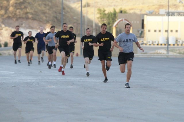 Active duty U.S. Army, U.S. Army Reserve and U.S. Army National Guard Soldiers, as well as a U.S. Air Force Airman, tackle the 1,000-meter run during the fitness test portion of the qualification for the German Armed Forces Proficiency Badge May 28, 2017, near Amman, Jordan. In addition to the 1,000-meter run, the fitness test also included a flexed arm hang and a sprint test. At the end of the three-day event, more than 50 U.S. Army Soldiers, U.S. Air Force Airmen and Canadian Armed Forces soldiers earned the GAFPB, a decoration of the German Armed Forces which is authorized for wear by the U.S. military.