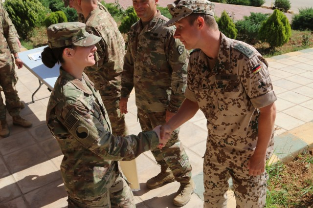 Spc. Jacqueline Waters, a Virginia National Guard Soldier assigned to the 29th Infantry Division, receives a certificate from Capt. Alexander Seelig of the German Armed Forces certifying her attainment of the German Armed Forces Proficiency Badge May 30, 2017, near Amman, Jordan. Waters was one of more than 50 U.S. Army Soldiers, U.S. Air Force Airmen and Canadian Armed Forces soldiers who earned the GAFPB following three days of rigorous physical events. The GAFPB is a decoration of the German Armed Forces which is authorized for wear by the U.S. military.