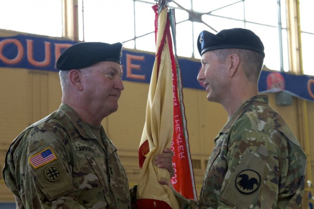 Maj. Gen Les J. Carroll passes the 377th Theater Sustainment Command flag to Maj. Gen. David J. Conboy, U.S. Army Reserve Command Deputy Commanding General (Operations), signifying the relinquishment of his command during a ceremony at Naval Air Station Joint Reserve Base New Orleans June 10, 2017. (U.S. Army photo by Sgt. Devin Wood)