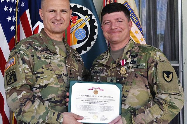Maj. Gen. Ed Daly, senior commander of Rock Island Arsenal, Illinois, and the commanding general of the U.S. Army Sustainment Command, presents outgoing command sergeant major, Command Sgt. Maj. Brian Morrison, 402nd Army Field Support Brigade, with the Meritorious Service Medal June 7. (Photo by Capt. Lonnie Collier, ASC Public Affairs)
