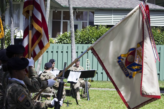 The flag of the 402nd Army Field Support Brigade is lowered in observance of the national anthem during the change of command and responsibility ceremony of the 402nd Army Field Support Brigade June 7. (Photo by Capt. Lonnie Collier, ASC Public Affairs)