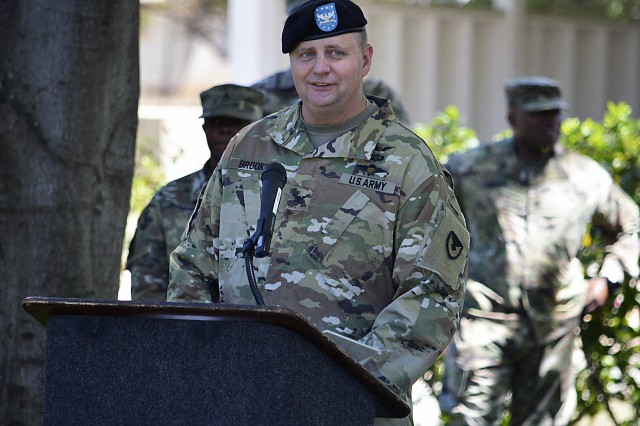 "Col. John ""Chris"" Brookie, incoming commander, speaks during the Change of Command and Responsibility ceremony for the 402nd Army Field Support Brigade. (Photo by Capt. Lonnie Collier, ASC Public Affairs)"