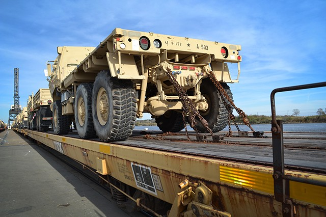The 842nd Transportation Battalion, 597th Transportation Brigade, Military Surface Deployment and Distribution Command, orchestrates terminal operations for the loading of unit equipment and the offloading of cargo at the Port of Beaumont and Port Arthur, Texas, in December 2013.