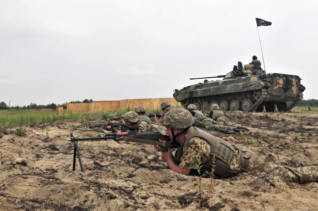 A BMP-2 provides support by fire to Ukrainian infantry during a platoon live-fire on June 23, 2016 at the International Peacekeeping and Security Center near Yavoriv.  The location is also the site of a new combat training center, developed with assistance from the 79th Infantry Brigade Combat Team out of the California National Guard.  It's expected that by 2018, the Ukrainian ground forces will be able to put brigade-sized elements through training at the CTC.