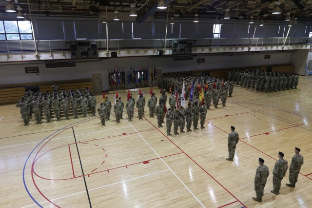 Soldiers assigned to 35th Air Defense Artillery Brigade stand in formation during the 35th ADA BDE change of command ceremony June 9 at Osan Air Base, South Korea. Col. Mark Holler relinquished command of the Dragon Brigade to Col. Richard Wright. (U.S. Army photo by Staff Sgt. Monik Phan)