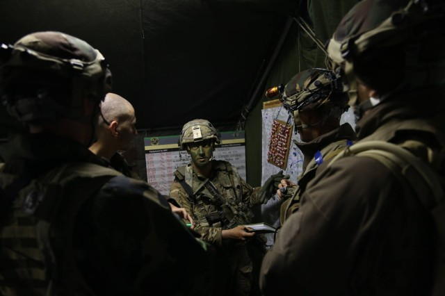 Soldiers of 1st Battalion, 66th Armor Regiment brief mission details to Hungarian soldiers of 3rd Bercsenyi Miklos Infantry Battalion while conducting tactical operations during Exercise #CombinedResolve VIII at the Hohenfels Training Area, Hohenfels, Germany, June 7, 2017. Combined Resolve is a multinational venue training the U.S. Army's Regionally Allocated Forces under Operation Atlantic Resolve to operate with the 10 NATO allied and partner countries participating, to promote stability and security in the region.