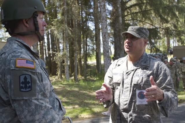 Oregon National Guard Brig. Gen. Mark A. Crosby, commander of Joint Domestic Operations, talks with Maj. Robert Wagner (left), training command executive officer at Camp Umatilla in Umatilla, Oregon, while observing Air Assault training held at Camp Rilea in Warrenton, Oregon, June 8, 2017.