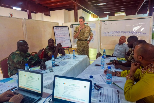 Exercise participants from more than 10 nations discuss interagency cooperation during working groups at Exercise Unified Focus, April 26, 2017, at the Douala Naval Base, Cameroon. UF 17 is a weeklong tabletop exercise that brings the military partners of the Lake Chad basin area's Multinational Joint Task Force (MNJTF) together to practice joint planning and coordination through a series of scripted vignettes.