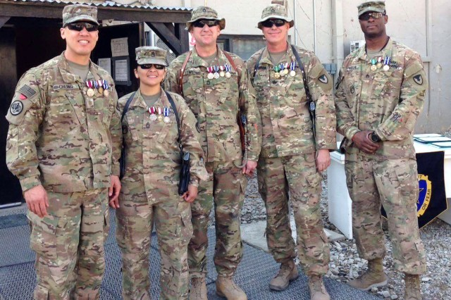 Members of the 607th Contracting Team stand in front of the Regional Contracting Center-Afghanistan in Bagram Airfield, Afghanistan. From left are Maj. Evan Chung, Master Sgt. Maria Sierra, Sgt. 1st Class Mark Lewis, Staff Sgt. Ryan Johnson and Staff Sgt. Ike Wright.