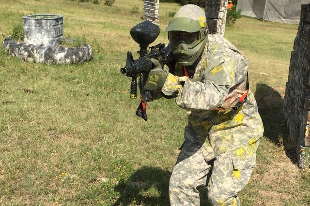 Master Sgt. Ray H. Barros, NCOIC of U.S. Army Operational Test Command's Mission Command Test Directorate, is on the run from cover, assaulting his opposing team while running the Warrior Adventure Quest paintball course at Belton Lake Outdoor Recreation Center.