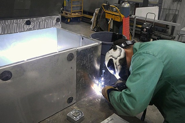 Staff Sgt. Joshua T. Lemire, an allied trades specialist with the Communications Support Detachment, Joint Communications Support Element, welds a metal fabrication. In the allied trades shop, sustainers can fabricate components for testing new communications processes and make repairs through machining and welding.