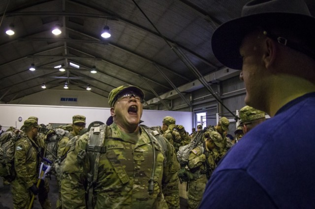 "A U.S. Army Soldier, assigned to Multinational Battle Group-East's Forward Command Post, recites ""Fiddler's Green,"" also entitled ""The Cavalrymen's Poem,"" during a spur ride on Camp Bondsteel, Kosovo, June 3. The spur ride is a Cavalry tradition wherein Soldiers must pass a series of mental and physical tests while under high levels of stress and fatigue."