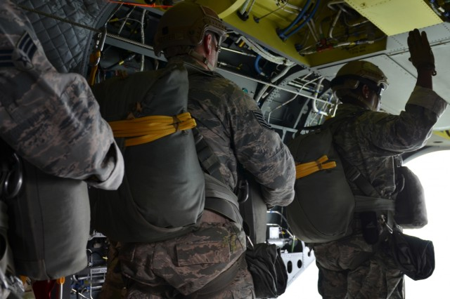 LIELVARDE AIR BASE, Latvia - U.S. Airmen from the 435th Contingency Response Group, 435th Air Group Operations Wing, Ramstein Air Base, Germany, prepare to step out of the aircraft, a CH-47 Chinook piloted by 10th Combat Aviation Brigade Soldiers, 10th Mountain Division, Fort Drum, New York, at Lielvarde airfield, June 10.  The 435th CRG is at Lielvarde to participate in Saber Strike, a U.S. Army Europe-led exercise in the Baltic region.  The exercise tests the capability of multiple nations to act against a threat.  The unit capitalizes on training opportunities; this is the first time the unit jumps from a Chinook. (U.S. Army photo by Sgt. Shiloh Capers)