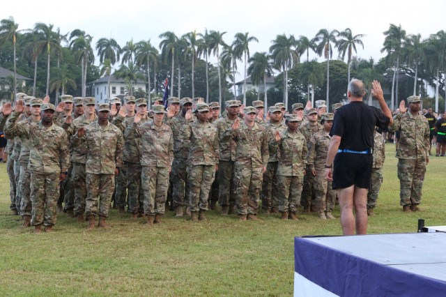 U.S. Army Pacific held a reenlistment ceremony, prior to a Family-Soldier Run/Walk, as part of a series of events during Pacific Theater Army Week, June 12 at Palm Circle on Fort Shafter. During the ceremony 33 Soldiers from across Oahu reenlisted, with a total of 253 years of service. Gen. Robert B. Brown, commanding general of USARPAC said he hoped the Soldiers would contribute another 144 years. (U.S. Army photo by Keith Dodson)
