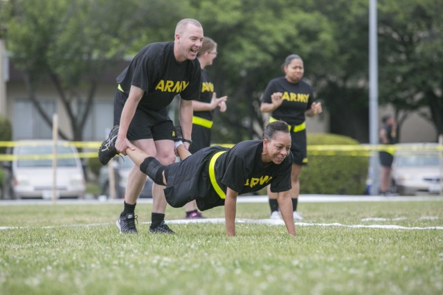 Camp Zama Soldiers participate in a wheelbarrow race June 9, 2017 for a field day hosted by the 78th Signal Battalion for the Female Enrichment Mentorship Program's day of teaming up to empower women. (U.S. Army photo by Honey Nixon)