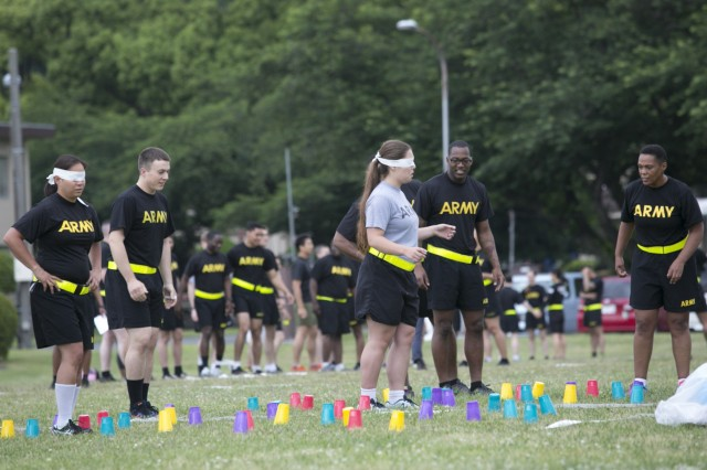 Camp Zama Soldiers participate in a blind walk June 9, 2017, attempting to avoid knocking the cups over, for a field day hosted by the 78th Signal Battalion for the Female Enrichment Mentorship Program's day of teaming up to empower women.  (U.S. Army photo by Honey Nixon)