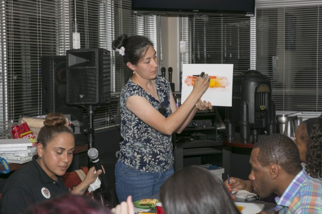 Domenika Leinbach, community member and art instructor, facilitates a painting exercise with Soldiers and community members June 9, 2017 for the Sip and Paint hosted by the U.S. Army Japan Headquarters and Headquarters Detachment in support of the Female Enrichment Mentorship Program. (U.S. Army photo by Honey Nixon)