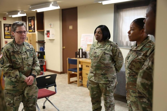 Members of the Equal Opportunity workforce within Area IV speak with Maj. Gen. Tammy S. Smith, Deputy Commanding General -- Sustainment, Eighth Army, following the conclusion of the 19th Expeditionary Sustainment Command, Headquarters and Headquarters Company's annual Pride Month Observance, June 7, 2017. Smith is the first openly gay general officer in the U.S. Army and was the guest speaker for this year's observance.