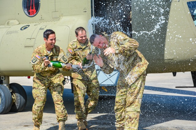 Chief Warrant Officer 5 Mike Sherman receives a traditional post flight wash from other CH-47 pilots after his final flight with the 12th Combat Aviation at Katterbach Army Airfield, near Ansbach, Germany Jun. 13, 2017.  The 12th CAB held a retirement ceremony for Sherman on Katterbach Army Airfield, Jun. 14, 2017, after 41 total years of service.  Sherman's 41 years in the Army include five combat deployments, four years as an enlisted 11E Armor Crewman, two years as a UH-1h Huey pilot, and 35 years as a CH-47 Chinook pilot.