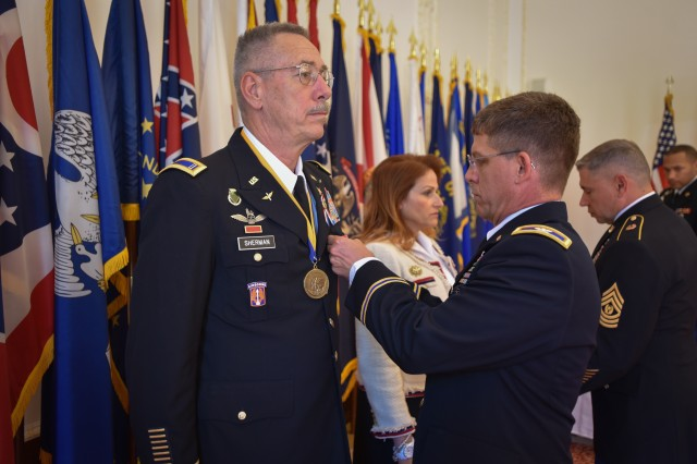 Chief Warrant Officer 5 Mike Sherman receives a Legion of Merit after 41 years of service in the U.S. Army during his retirement ceremony at Katterbach Army Airfield, near Ansbach, Germany Jun. 14, 2017.  Sherman's 41 years in the Army include five combat deployments, four years as an enlisted 11E Armor Crewman, two years as a UH-1h Huey pilot, and 35 years as a CH-47 Chinook pilot.