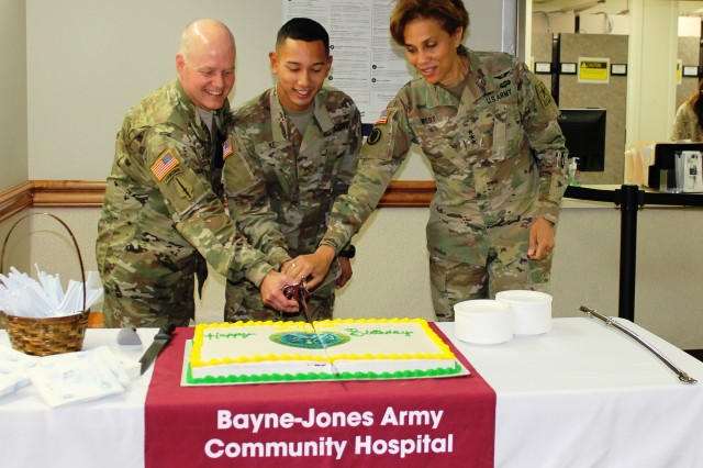 Lt. Gen. Nadja West, Army Surgeon General, celebrated the 242nd Army Birthday with Bayne-Jones Army Community Hospital staff, beneficiaries and retirees. She told the crowd that Army Medicine has been around since 1775 and that she was honored to be here on this special day. Lt. Gen. West, the highest ranking woman graduate of West Point, joined Col. Jeffery Lawson, Chief Medical Officer, also a West Point graduate and the most senior officer with 37 of service and Pvt. Austin Ke, a Nutritional Care Specialist with only eight months in the Army, in the ceremonial cutting of the cake. After the official part of the ceremony was completed Lt. Gen. West posed for photos and talked with staff and retirees. Lt. Gen. West was visiting BJACH and the Joint Readiness Training Center at Fort Polk, La.