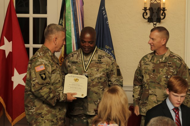 Lt. Gen. Stephen Twitty, center, commanding general of First Army at Rock Island Arsenal, Ill., is inducted into the Army Reserve Officers' Training Corps hall of fame during a ceremony June 14, 2017, at the Saber and Quill on Fort Knox, Ky. Twitty has served in the U.S. Army for 36 years.