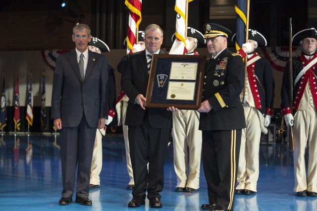 As part of a June 14, 2017 twilight tattoo event at Joint Base Myer-Henderson Hall, Va., held on honor of the Army's 242nd birthday, Acting Secretary of the Army Robert Speer, left, and Chief of Staff of the Army Gen. Mark A. Milley, right, present a posthumous Distinguished Flying Cross for Army Capt. James E. Miller to Miller's great grandson, Byron Derringer, center.  Miller served as a pilot during World War I, and was the first combat aviation casualty of the war.