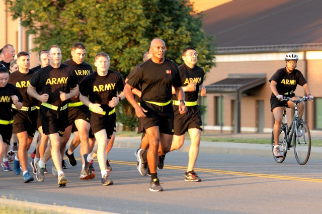 Col. Flint Patterson, commander of the 4th Cavalry Multi-Functional Training Brigade, leads his troops during a post run June 14, 2017, on Fort Knox, Ky., in celebration of the U.S. Army's 242nd birthday.