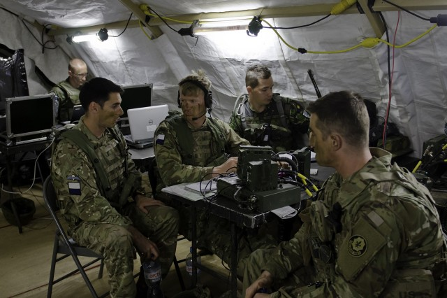 British, Romanian and U.S. Soldiers discuss operating procedures for the battle group during the defensive phase of the multinational Field Training Exercise as part of Saber Strike 17 in Bemowo Piskie, Poland June 14, 2017. Saber Strike 17 is a U.S. Army Europe-led multinational combined forces exercise conducted annually to enhance the NATO Alliance throughout the Baltic region and Poland. This year's exercise includes integrated and synchronized deterrence-oriented training designed to improve interoperability and readiness of the 20 participating nations' militaries. (U.S. Army photo by Sgt. Justin Geiger)