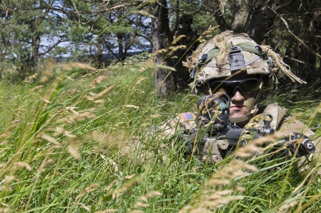 U.S. Soldiers assigned to Battle Group Poland move to high ground to search for potential enemy threats during the multinational Field Training Exercise as part of Saber Strike 17 in Bemowo Piskie, Poland June 14, 2017. Saber Strike 17 is a U.S. Army Europe-led multinational combined forces exercise conducted annually to enhance the NATO Alliance throughout the Baltic region and Poland. This year's exercise includes integrated and synchronized deterrence-oriented training designed to improve interoperability and readiness of the 20 participating nations' militaries. (U.S. Army photo by Sgt. Justin Geiger)