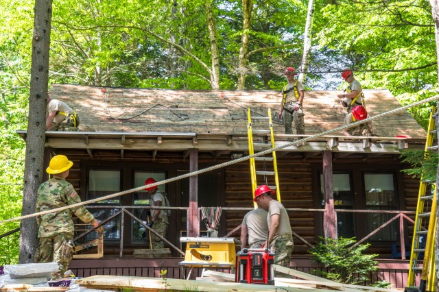 Soldiers of 3rd platoon from the 136th Engineer Company (Vertical) fixing the roof of one of the cabins at Camp Susan Curtis, Stoneham, Maine. These construction projects are part of the units Innovative Readiness Training (IRT), a program which allows these soldiers to conduct basic tasks and drills while also helping out their community.