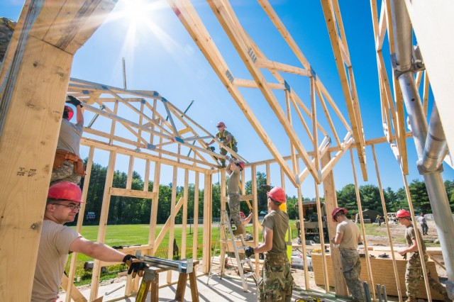 Soldiers from 2nd platoon of the 136th Engineer Company (Vertical) begin add roof trusses a concession stand project in Casco, Maine. These construction projects are part of the units Innovative Readiness Training (IRT), a program which allows these soldiers to conduct basic tasks and drills while also helping out their community.