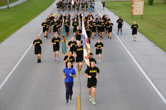 Missouri Gov. Eric Greitens, bottom left, joined Maj. Gen. Kent Savre, Maneuver Support Center of Excellence and Fort Leonard Wood commanding general, at 5:30 a.m. to lead a division-style run with thousands of Soldiers.