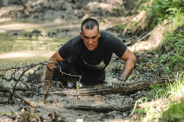 James Juarez crawls through a mud pit as he enters the final stretch of the Volkslauf 10k course Saturday.