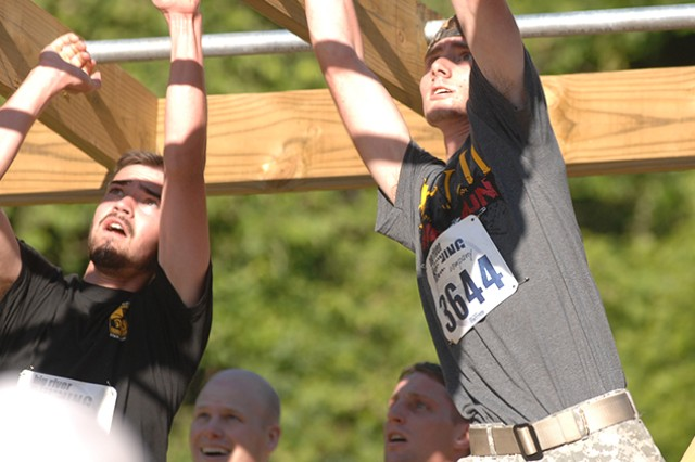 Brian Rodger completes the monkey-bars obstacle Saturday during the Volkslauf 10k fun run. Nearly 700 participants took part in the annual run, which featured steep hills, multiple obstacles, mud pits, river crossings and more.