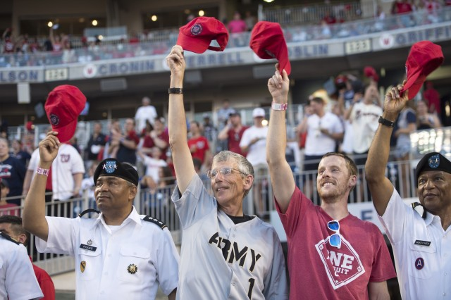 Acting Secretary of the Army Robert M. Speer tips his cap during the 3rd inning of this year's U.S. Army Day at the Nationals Park, Washington D.C., June 13, 2017.