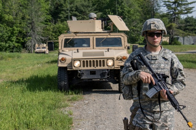 A noncommissioned officer from the 488th Military Police Company stands guard during the unit's annual training at Plymouth Training Site.  Their training lasted over a week during which they conducted events such as vehicle recovery, patrolling, security measures, Humvee operations, and vehicle maintenance.  Their training was also host to their annual event, the Best Military Police Squad Competition.  This put nine squads from the unit head to head in a physical and mental test lasting 12 hours.  The competition tested each squads, physical training, ruck march ability, medical skills, radio communication proficiency, and much more.